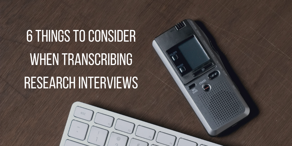 Text: 6 things to consider when transcribing research interviews overlaid in white over image of wooden desk with tape recorder and keyboard